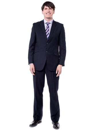 Full length image corporate man standing over white.