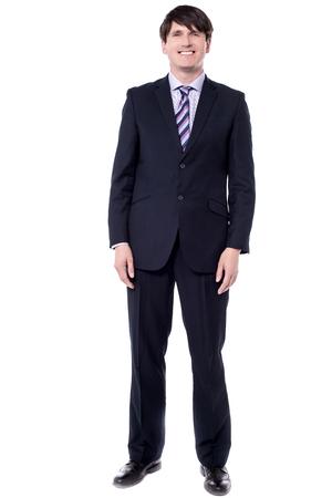 Full length image corporate man standing over white.