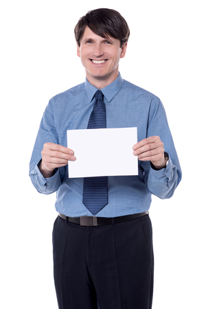 Picture of a smiling businessman holding a white board. Stock Photo