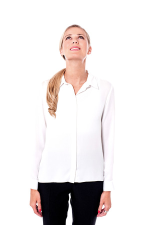 Picture of businesswoman looking up against a white background. Stock Photo