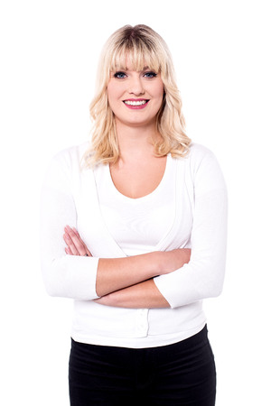 Confident business woman with elegant smile over white.