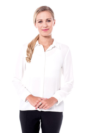 Studio shot of business woman against white background.