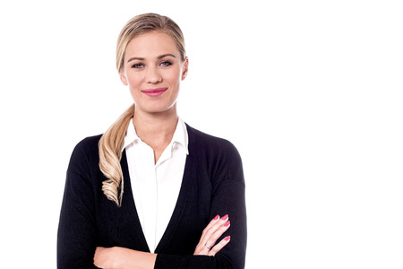 Female entrepreneur posing to camera with folded arms.