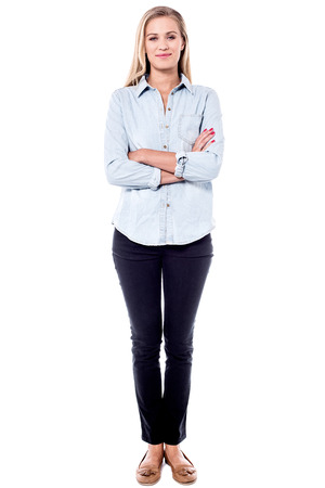 Full length image of female model with crossed arms.