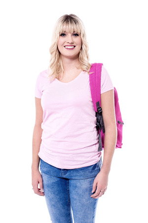 Beautiful lady with backpack, isolated on white background. Stock Photo