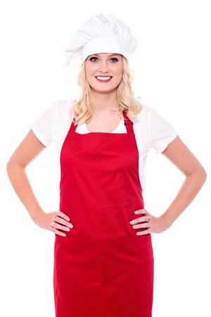 hands on waist: Confident female chef with her hands on waist.