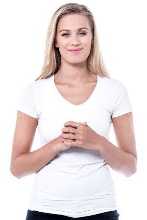 clasped: Beautiful young lady with her hands clasped