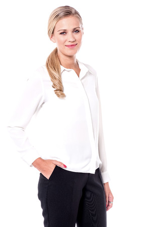 stylishly: Young business woman posing stylishly over white