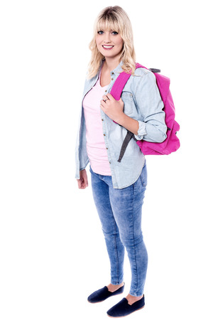 Attractive woman with backpack posing to camera.