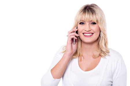 Portrait of a young woman talking on mobile phone. Stock Photo