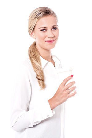 causal: Beautiful woman with paper cup against white background. Stock Photo