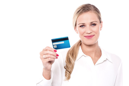 debit card: Young female corporate executive offering debit card. Stock Photo