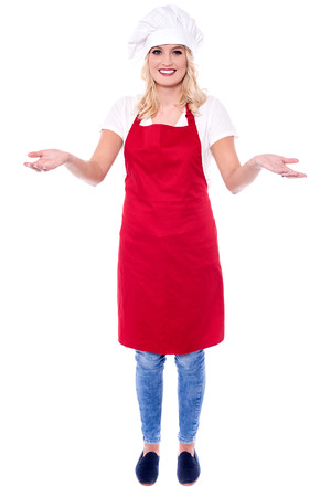 arms wide open: Chef posing in uniform with her arms wide open. Stock Photo