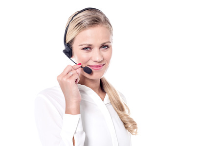 Pretty female customer support executive on customer call.
