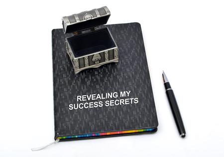 company secrets: Revealing my success secrets diary and pen.