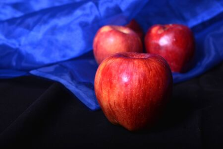Fresh Apples with blue and black background.