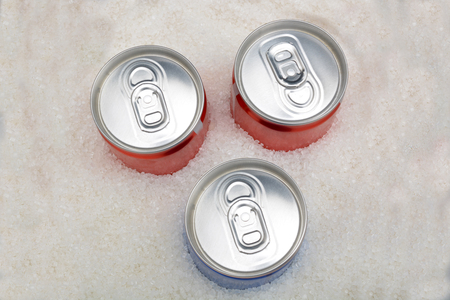 carbonated: Sugar in carbonated drinks. sweet background and canned drinks concept.