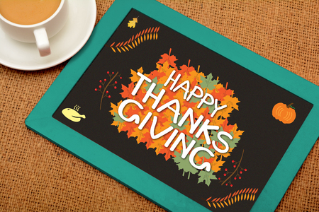Happy thanksgiving drawing on chalkboard with colorful cup Stock Photo