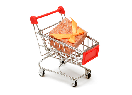 Gift Box in Shopping Cart on white background