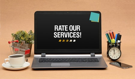 Rate our Services Sign with Stars on Laptop Monitor 写真素材