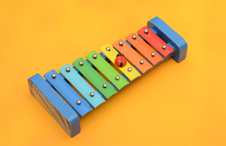 Xylophone children music playing ornament yellow background