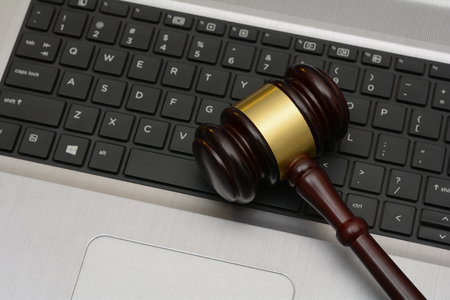 Online Auction wooden Gavel on computer keyboard Фото со стока