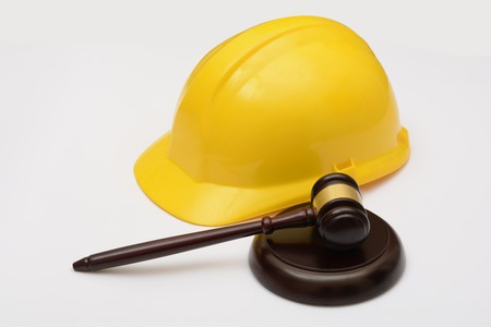 Labor Law with safety helmet and gavel Stock Photo