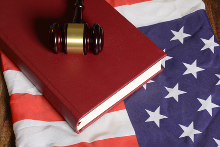 Gavel with law book on American flag