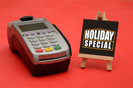 Holiday Special sale sign with credit card swipe machine Archivio Fotografico