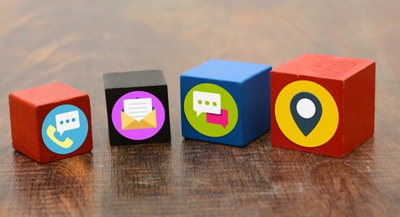 Contact Us Means Icons on wooden blocks.