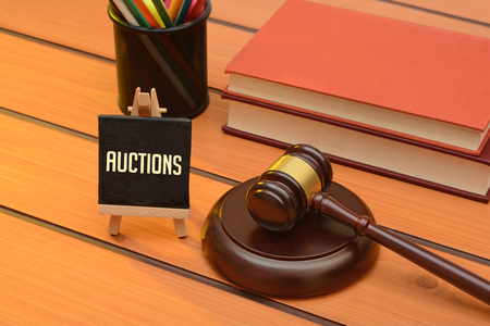 Auction with Wooden Gavel on table, law background