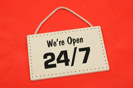 We are open sign on red cloth background Stock Photo