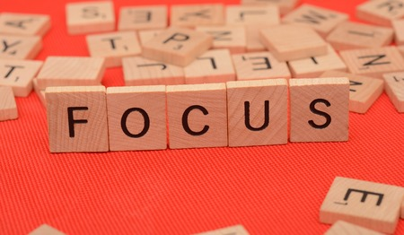 Focus word text block on red cloth background