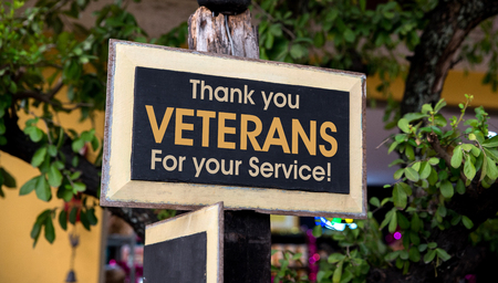 Thank you Veterans written on a Wooden Sign Board