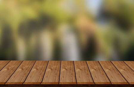 wooden desk in garden and free space for text, vintage texture background