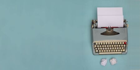 Vintage typewriter and crumpled papers with copy space banner
