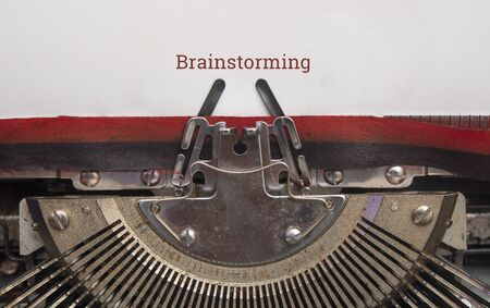 Text of brainstorming on paper with old Manual Typewriter top view, copy space