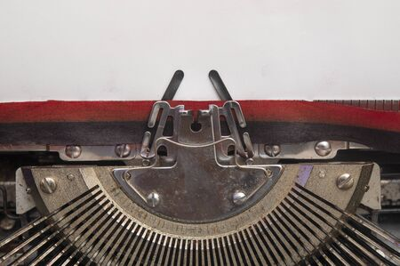 Old manual typewriter with blank white paper top view, copy space