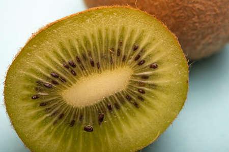 Isolated Kiwi fruit half sliced on blue background