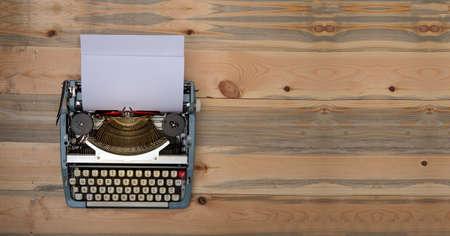 Vintage typewriter with wooden banner background