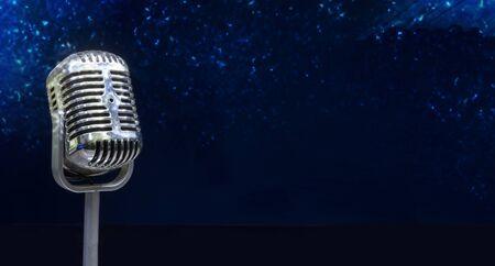 Close up vintage microphone on black background, music concert.