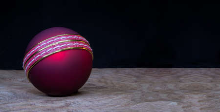 Close up cricket Ball on wooden background with copy space