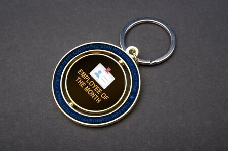 Close up view of employee of the month badge and Keychains with copy space