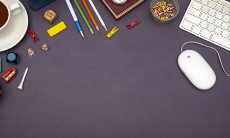 Office table top view with stationery items.