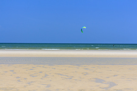 Kite surfing at the sea photo
