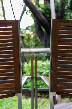 two wood armchair in garden photo
