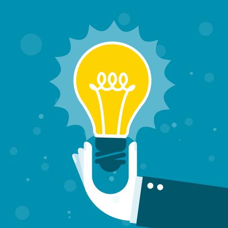 shining light: Innovation - hand holds shining light bulb