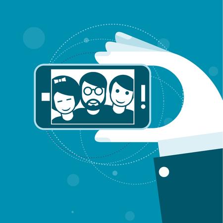 smartphone hand: Selfie with friends - smartphone in hand