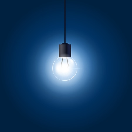 filament: Light bulb hanging on cord on blue background