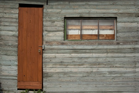 log wall: Background of old wall with window and door